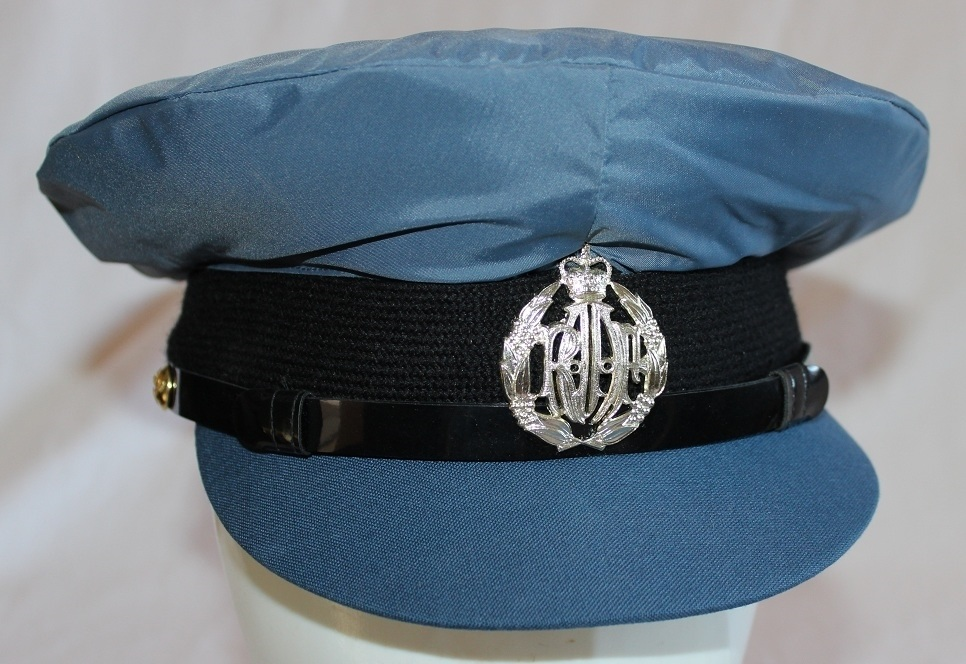cab9b11c An unnamed ranks service dress cap with an anodised cap badge and a nylon  rain cover. The cap is lined with a blue/grey material that is covered with  thin ...
