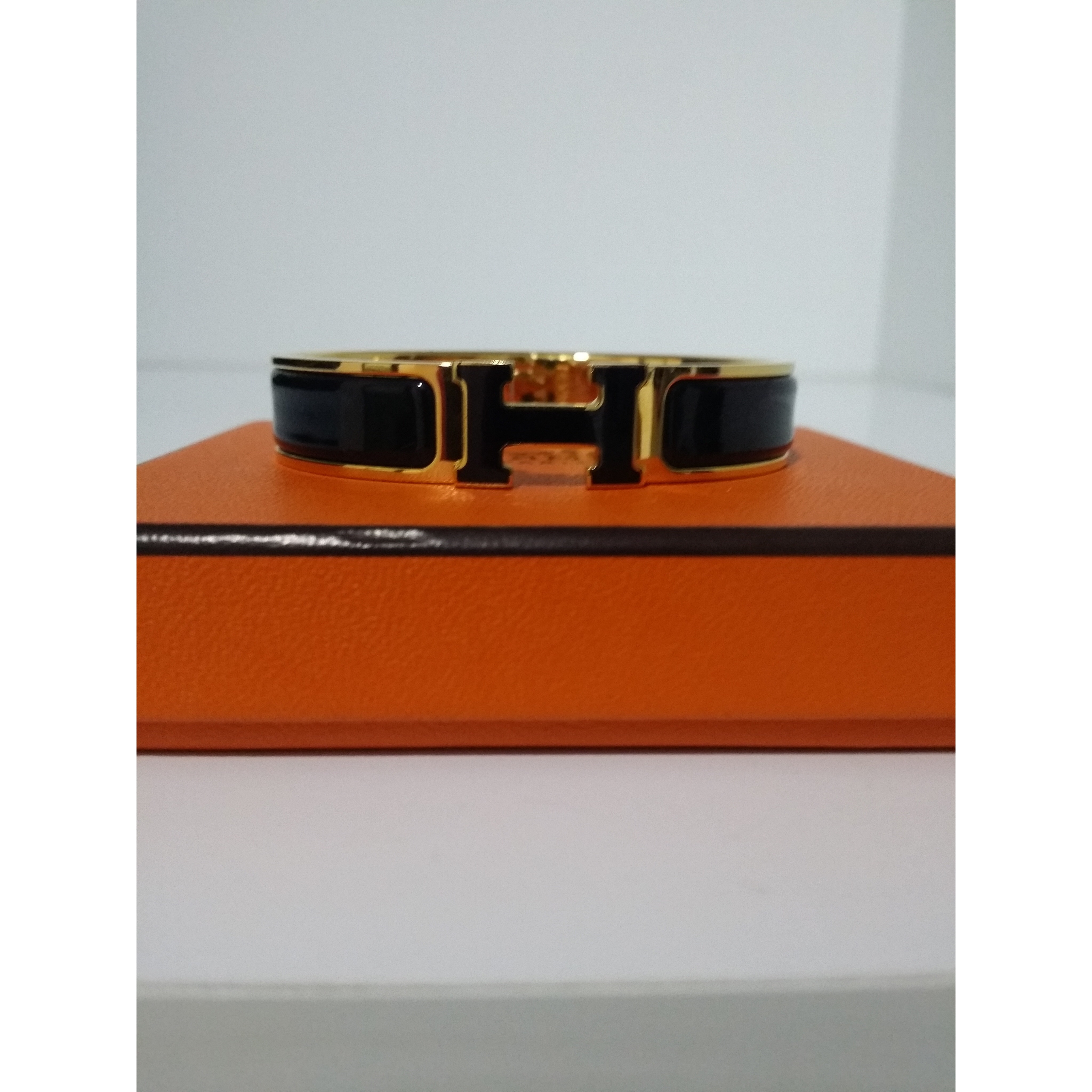 3ec38f68164b 965a2 bc92a  france hermes clic h black enamel ghw size pm includes box  dustbag. condition fine scratches