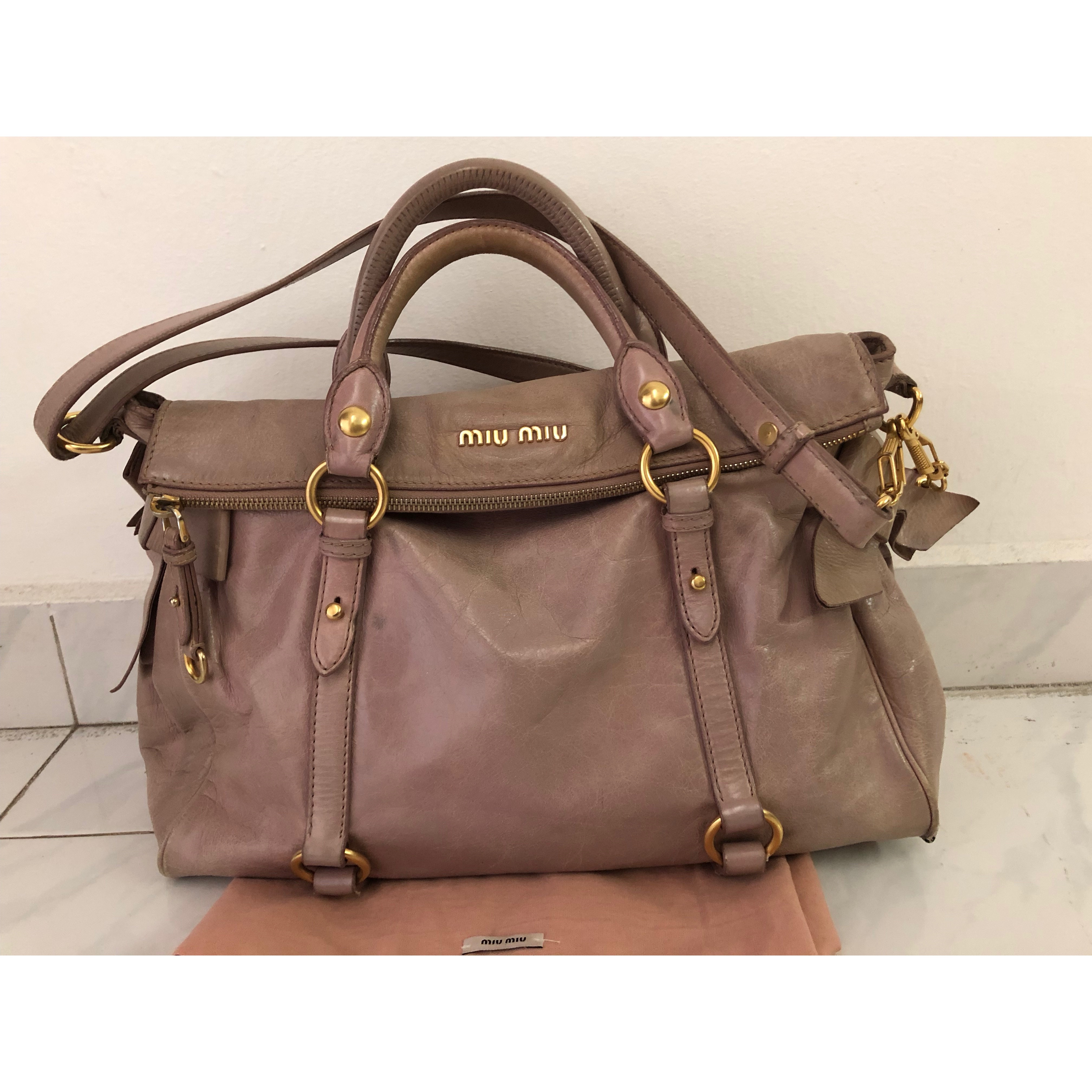 25182b53afa Miu Miu vitello bow bag in large size Size   37 cm x 25 cm x 12 cm  Condition   Fair Colour Material   dusty pink  leather INCLUDED ITEMS  STRAP, ...