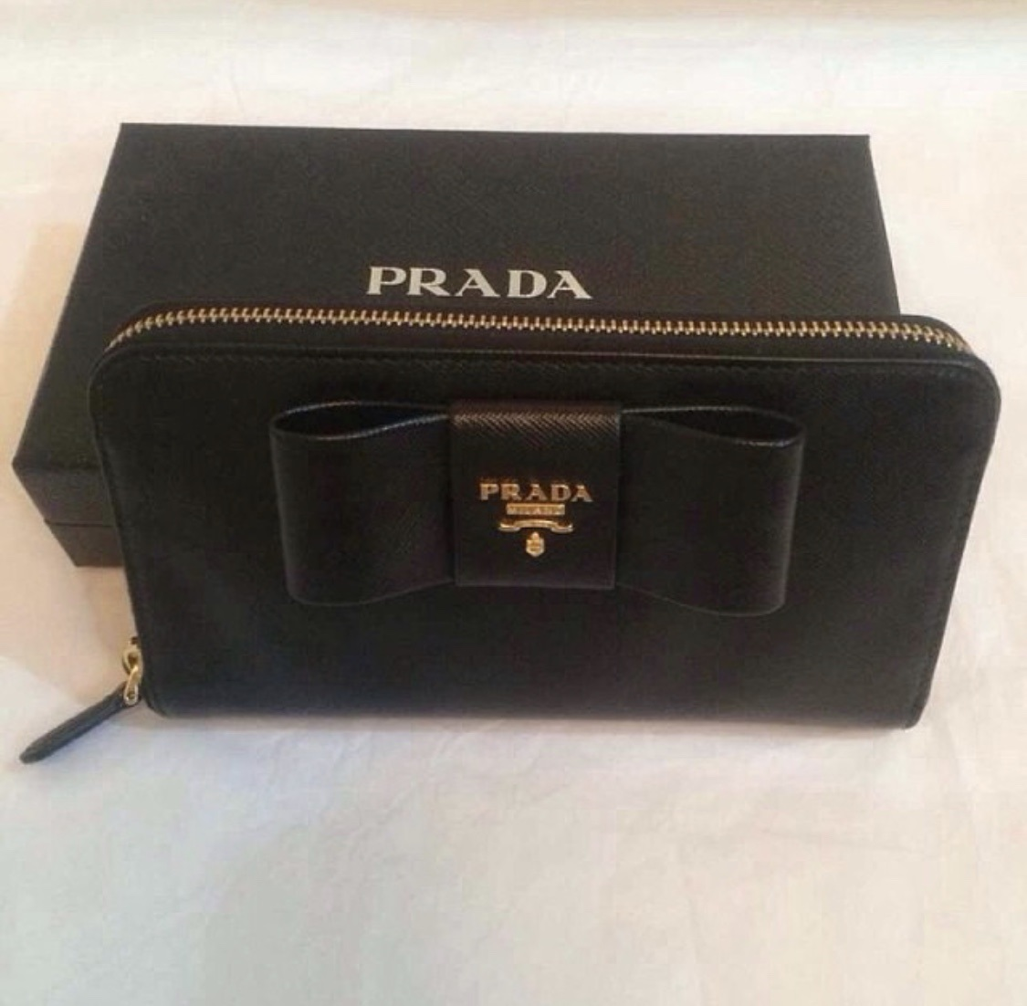 536b6213e450 ... new zealand prada bow wallet with zip condition great condition color  black material saffiano leather comes