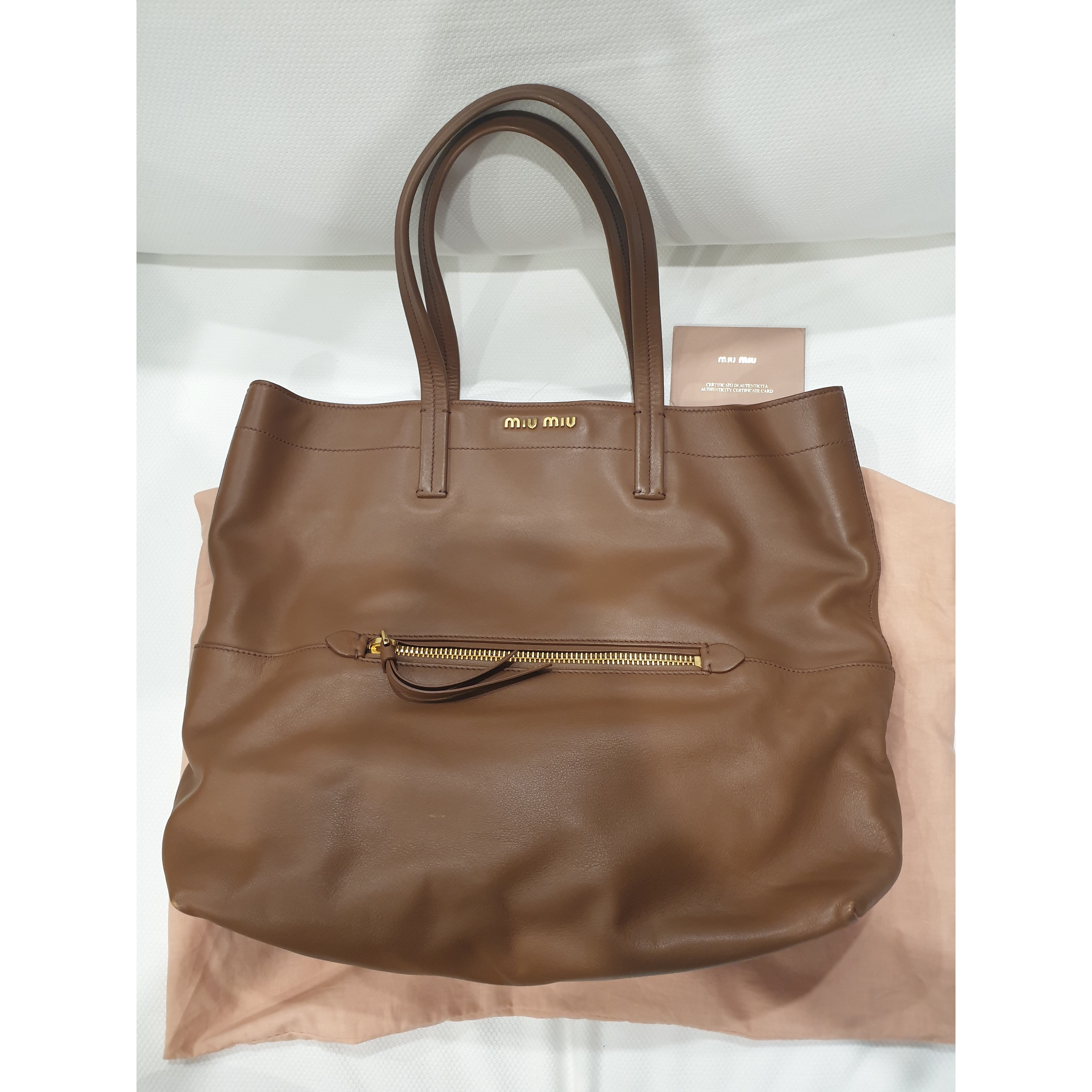 06c4bdc7938a Miu Miu Tote Condition   8 10 (minor scuff on corners) Color Material    Lambskin comes with dustbag and cards. Prefer cod so you can inspect the  bag prior ...