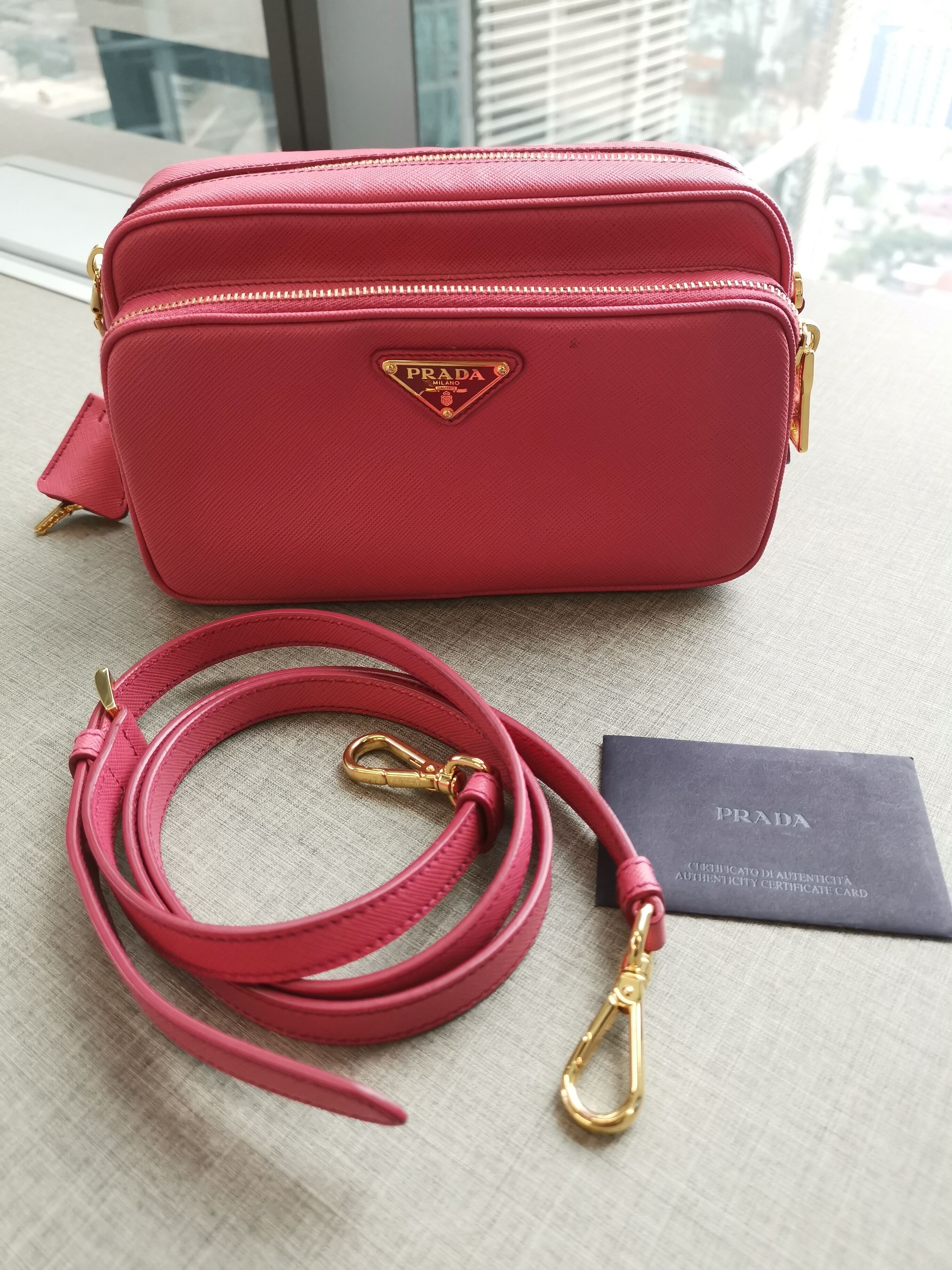 06d6dc2637d313 Prada safiano Double Zip Sling Bag Condition : 8.5/10 Color/Material :  Fushia come with dust bag only. Selling Price : SGD 935 / RM 2800 Contact  via ...