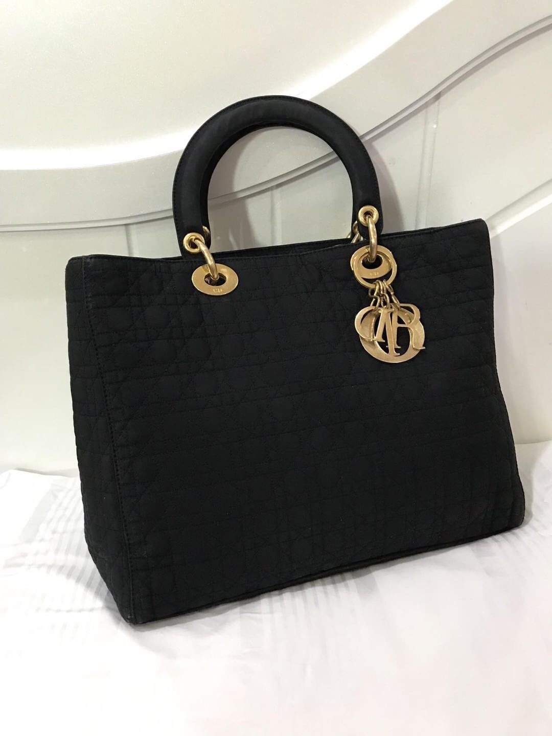 25d9324524f7 Lady Dior Large Microfibre Bag in black with GHW Measurements   32L x 24H x  11W cm Condition   7 10 Color Material   Microfibre fabric in black  Timeless ...
