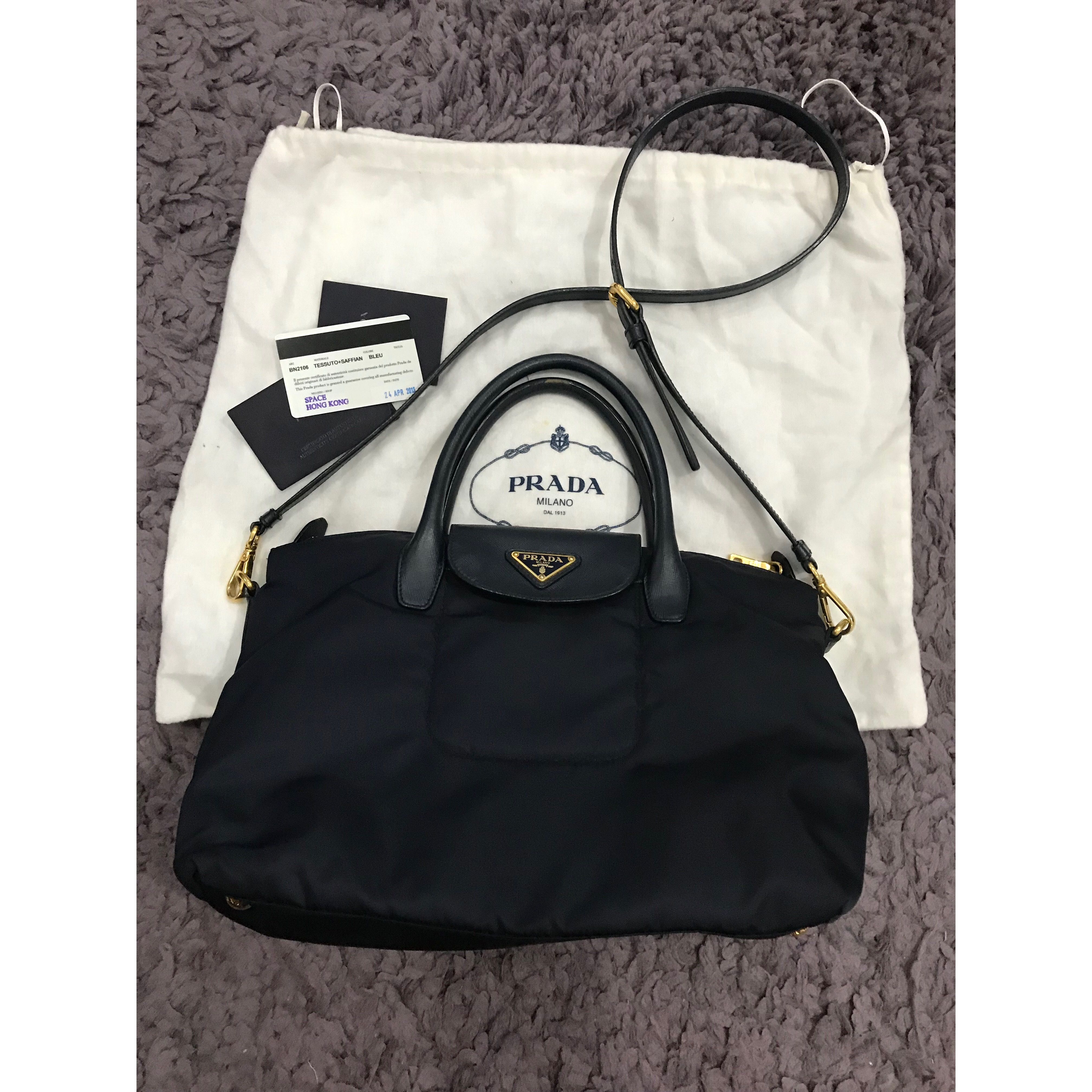 13e274d1781c85 Prada in blue black colour Condition : 8.5/10 selling very cheap Selling  Price : SGD485 / RM1,450 only WhatsApp for more details Contact via  WhatsApp : + ...