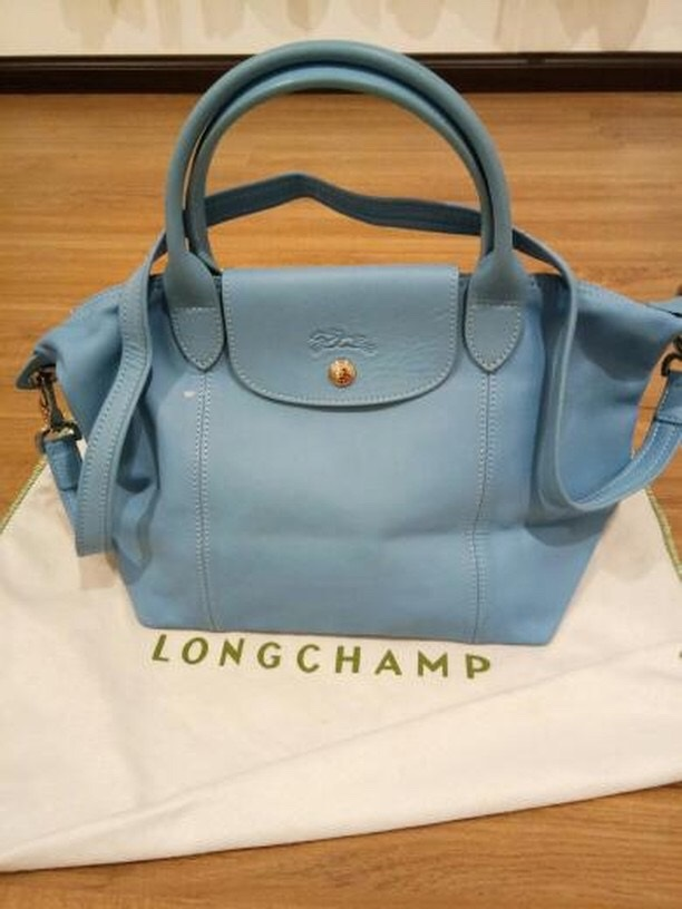 83a3dc055443fb Longchamp Le Cuir (Leather) Measurements : 12W x 10.5H x 6.5D inch (small  size) Condition : 8/10 Color/Material : Baby blue/soft leather with canvas  lining ...