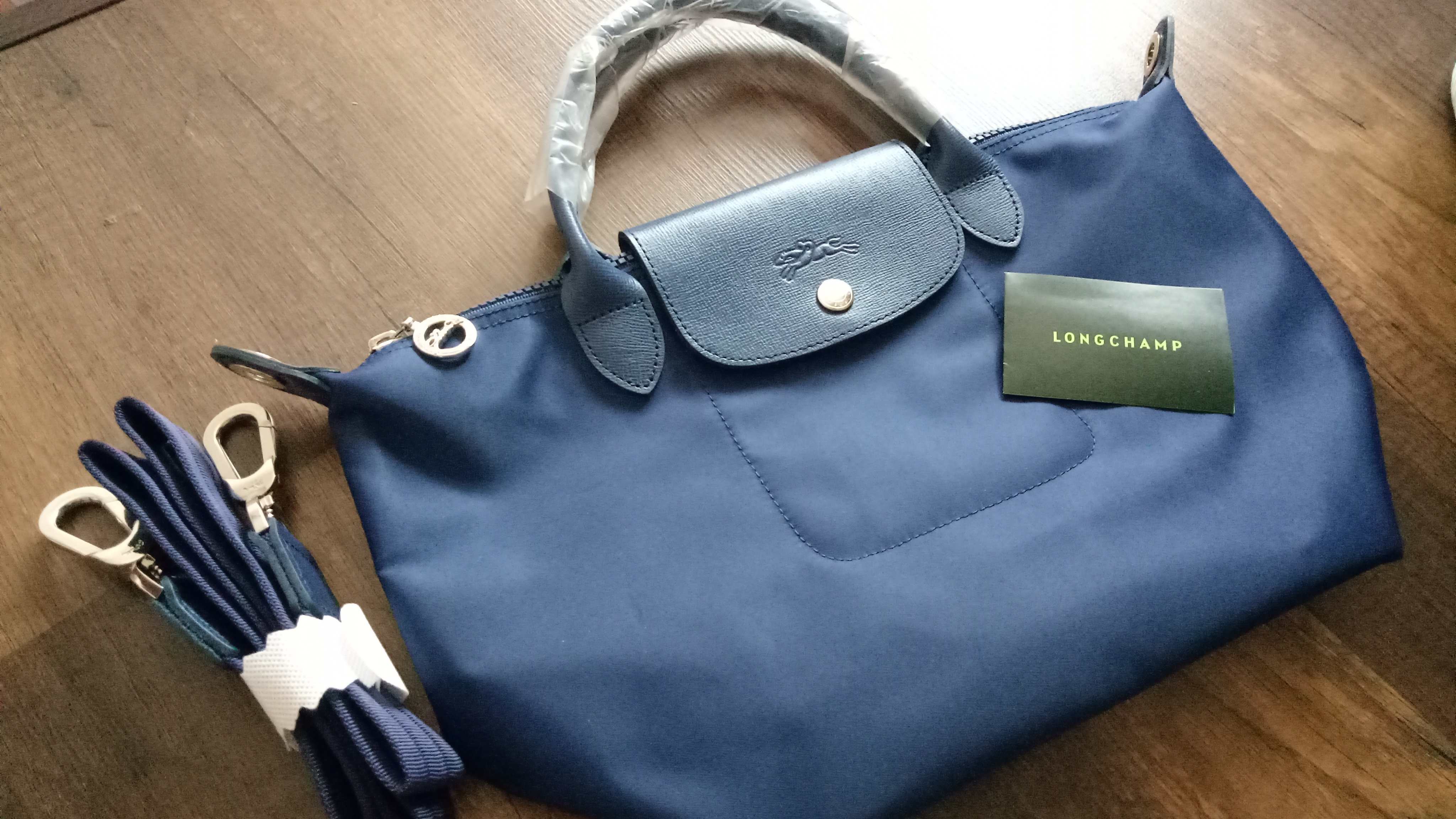 78f122e6cd4 Longchamp Neo Small with strap Measurements : 9.8x9x6.3x14.6x4.7inch  Condition : 10/10 new unused Color/Material : Navy blue New unused. Bag and  carecard ...