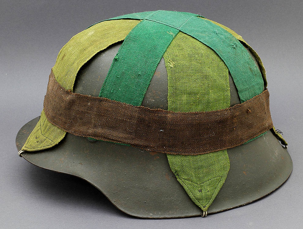 f696bd521d504 M42 ckl64 with a field depot-made camouflage band comprised of textiles  used by the Wehrmacht in Norway (1940-1945). Several examples of these  camouflage ...